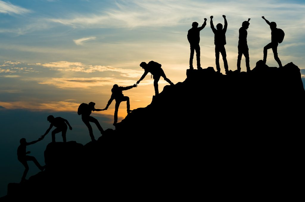 Group of people on peak mountain climbing